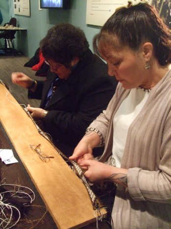 Veranoa Hetet (right) and Kahu Te Kanawa working on Veranoa's kākahu in the Weavers' Studio. Copyright Te Papa.