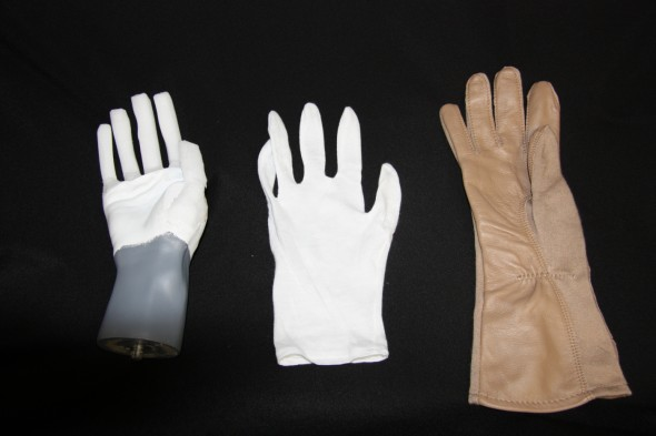Mannequin hands with rebuilt fingers constructed of armature wire and archival foam.  Image copyright Te Papa.