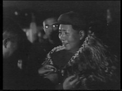 Chairman Mao Zedong wearing the feather cloak presented by Ramai Hayward on behalf of King Korokī, 1957. Image still from National Film Archive.