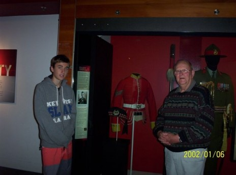 Graham Jackson and Matt Raines checking out Sergeant John Smith Jackson's uniform, 2012.