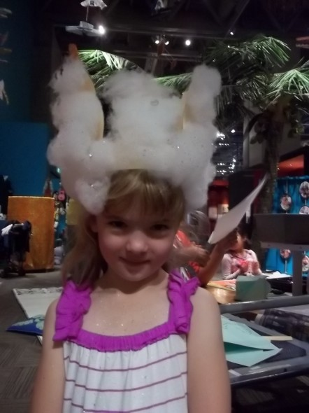 A snow angel landed on this visitor's headband. Photo Ruth Hendry. © Te Papa.
