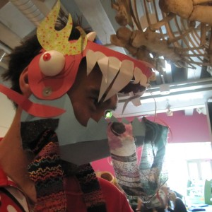 Michael Discovery Centre Host wearing dragon mask