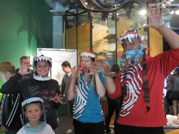 Discovery Centre hosts and visitors wearing dragon masks