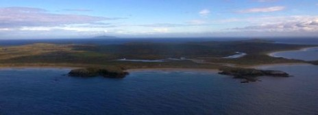 Ruapuke Island from the south-east, with Bluff Hill in the distance. Image: Colin Miskelly