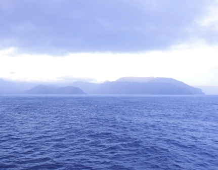 Arriving at the Crozet Islands, Ile de la Possession in the early morning clouds. Image: Susan Waugh, © Te Papa