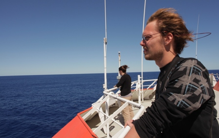 Julien Collet CNRS Research Assistant keeps an eye out for whales and seabirds from the top deck of the Marion Dufresne. Image: Susan Waugh, © Te Papa