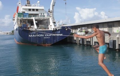 Marion du Fresne and local boy at port in St Denis La Reunion. Image: Susan Waugh, (C) Te Papa.