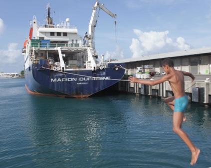 Marion du Fresne and local boy at port in St Denis La Reunion. Image: Susan Waugh, (C) Te Papa.