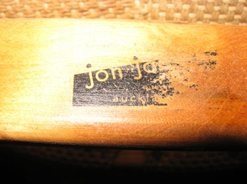 The 'jon jansen' stamp appears on the inside of the back rail. Te Papa