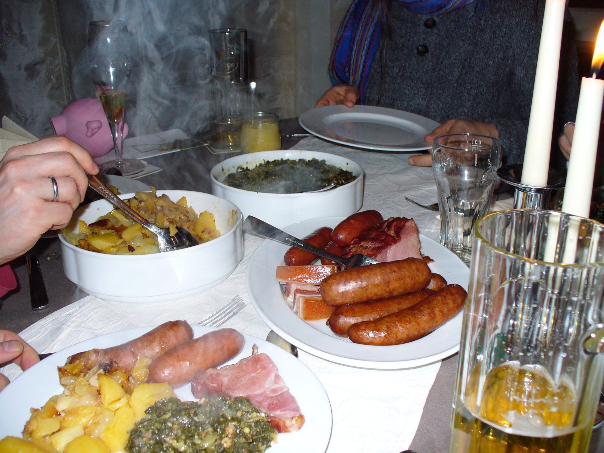 """Our traditional northern German dinner after the """"kale walk"""", including two types of German sausages (Pinkel and Kochwurs), potatoes, and (of course!) kale! Feb 2013. Photo by Silvia Kempen."""
