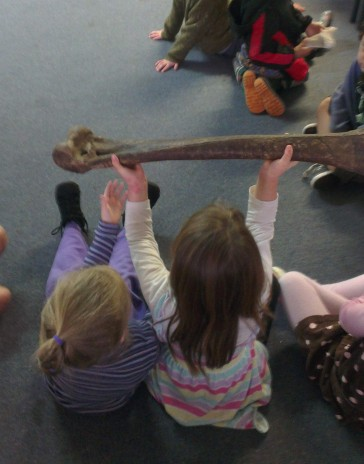 Students holding a moa bone at Dyer Street School. Photographer: Troy Murphy © Te Papa