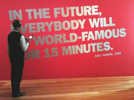 Warhol: Immortal audio guide in use. 6 June 2013. Photographer: Flo Wilson ©  Te Papa. Quote is Andy Warhol, 1968
