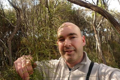 Caption: Me and the giant, 2. Lycopodium deuterodensum, Karikari Peninsula, Northland. Photo © Leon Perrie.