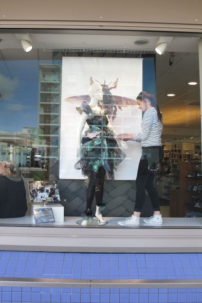 Rosie working on installing her garment in the window at Te Papa. © Te Papa