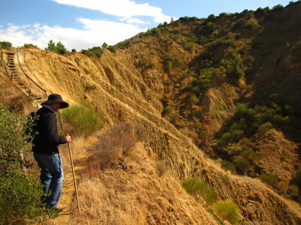 Ian McGibbon, on the NZ Track, heading toward Chununk Bair. In this photo, you can make out the steepness of the terrain. Photograph by Puawai Cairns, copyright Te Papa 2013