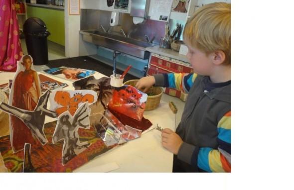 Max, age 4.Creating his diorama with a mirror 'river', magazine cut outs, fabric, and hand drawn 'God of Death'.Photographer: Tai Tamariki, © Tai Tamariki