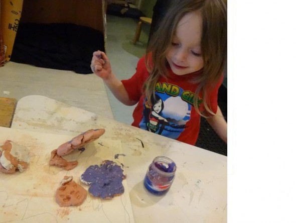 Piperita, age 3. Taking great delight in working with and painting modelling clay to create her diorama. Photographer: Tai Tamariki, © Tai Tamariki