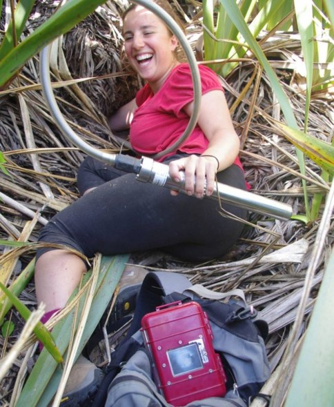 Te Papa volunteer Lizzy Crotty having way too much fun with a burrowscope. Image: Colin Miskelly, Te Papa