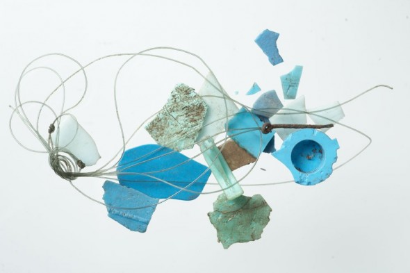 Plastic debris found on the shearwater breeding colony at Ohinau Island, including bottle caps, nylon fishing line with hook attached (broken off). The blue-green colour of these debris was consistent throughout the areas we found plastic in the shearwater colonies. Photo: Jean-Claude Stahl, Copyright: Te Papa.