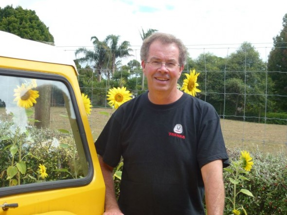 Todd stands with his canary yellow Trekka. © Todd Niall