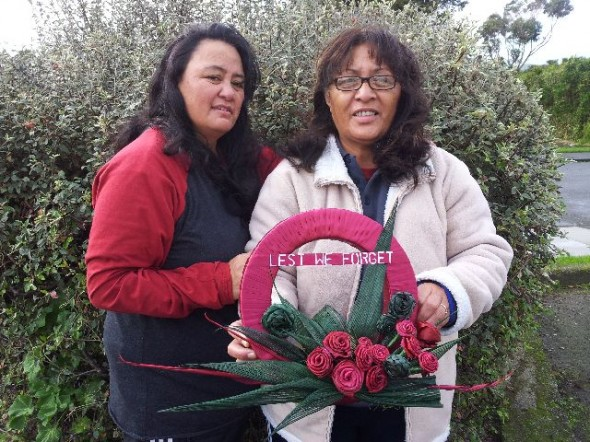Sarah Parai and Rei Warren with their harakeke wreath for the commemorative war  section