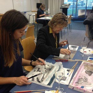 Teachers using oil paints in the landscape art professional development workshop.