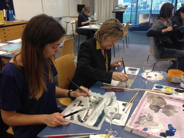 Teachers using oil paints in the landscape art professional development workshop.