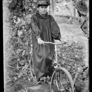 Portrait of a female cyclist, circa 1914, Cook Islands. Crummer, George. Te Papa