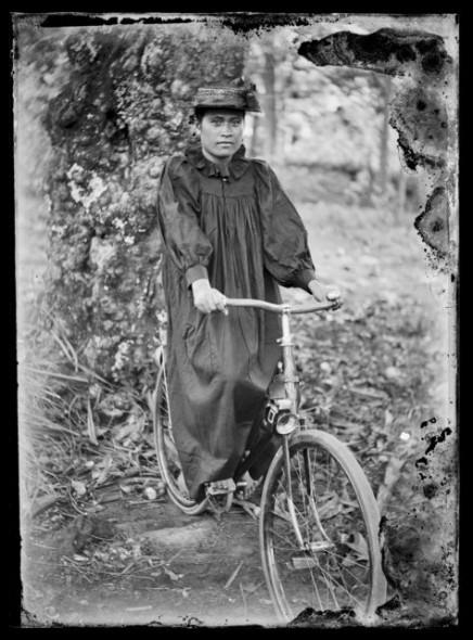 Portrait of a female cyclist, circa 1914, Cook Islands. Crummer, George. Te Papa