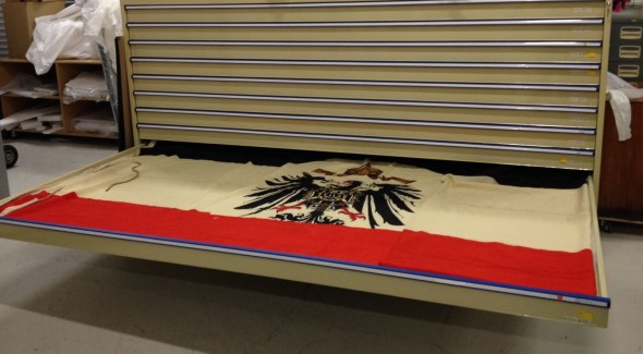 German flag in Pacific Cultures collections store room (FE003647 Te Papa)