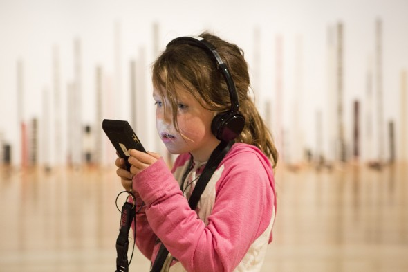 Child listening to kids audio guide. Photo Mike O'Neil. © Te Papa