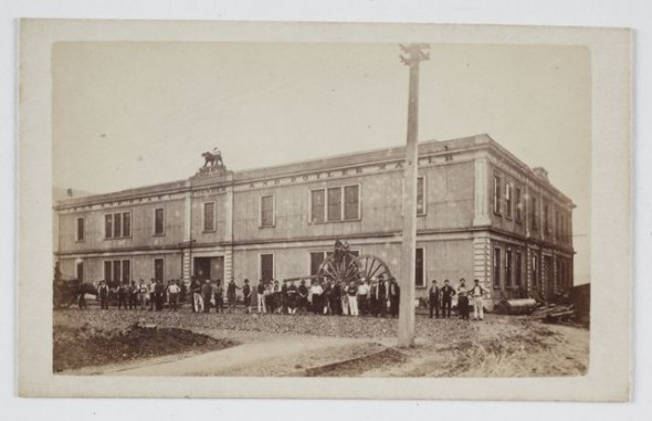 Wrigglesworth & Binns. E. W. Mills Premises, corner Customhouse Quay and Waring Taylor Street, circa 1870, Wellington. Gift of Mrs E W Gibbs, 1933. Te Papa