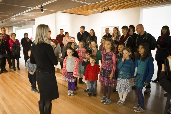 Educator Helen Lloyd congratulating children who feature on the kids audio guide. Photo Mike O'Neil.  © Te Papa