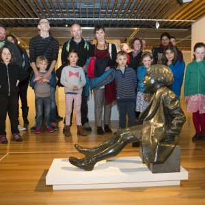 Children from Crofton Downs Primary schools with their teachers and families with the sculpture Little Girl, by Sydney Harpley. Photo Mike O'Neil. © Te Papa