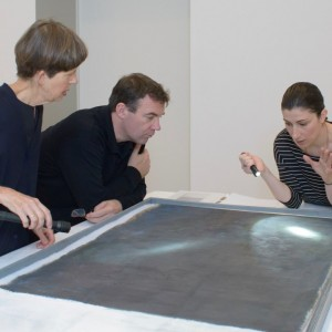 Sarah Hillary, Tom Learner and Tijana Cvetkovic discussing the painting's surface. Image courtesy of Auckland Art Gallery Toi o Tamaki