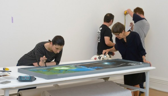 Tijana Cvetkovic and Sarah Hillary condition checking the painting's surface. Image courtesy of Auckland Art Gallery Toi o Tamaki
