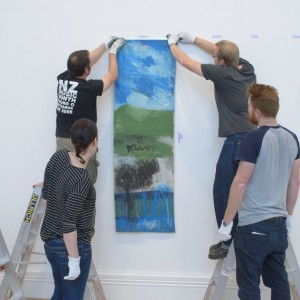 During installation of Northland Panels. Image courtesy of Auckland Art Gallery Toi o Tamaki