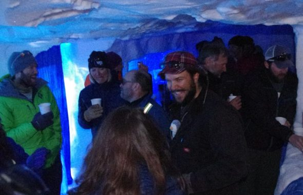 Making the most of the cold environment. ANI staff and guests socialise in the snow cave. Image: Colin Miskelly