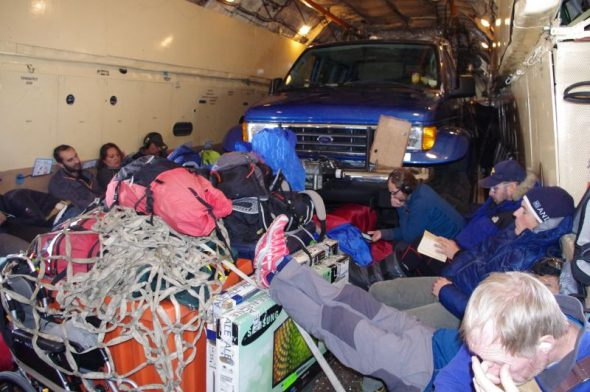ANI staff try to make themselves comfortable alongside cargo inside the Ilyushin jet. Image: Colin Miskelly