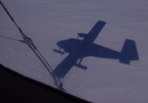 The shadow of a ski-equipped Twin Otter about to land at South Berkner fuel cache. Image: Colin Miskelly