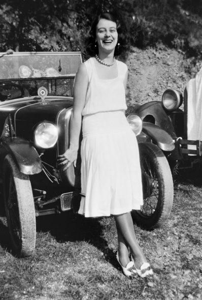 Woman beside car.