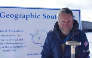 The author standing beside the 2014 Geographic South Pole marker. Image: Colin Miskelly