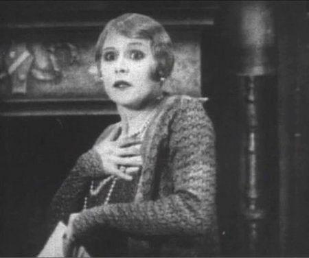 It's enough to make you clutch your (rough) pearls. Still from Easy Virtue (1928), sourced from  http://www.alienspouse.com/jen_weblog/2011/05/easy-virtue-1928.html