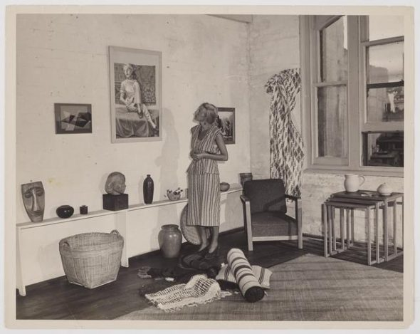 'Helen Hitchings inspecting a self -portrait on display in her Gallery', circa 1950, by Photo News Ltd (Wellington, N.Z.). Te Papa (CA000124/001/0060)