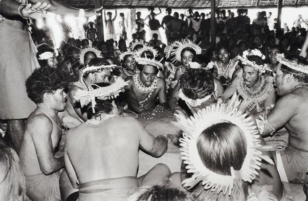 Tony Whincup, 'Beating a box for dance accompaniment', Bairiki village, South Tarawa, Kiribati, 1978. Gelatin silver print, O.033043, Te Papa.