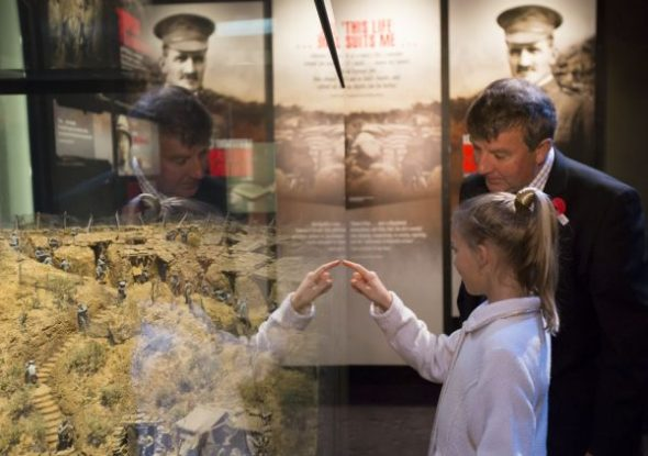 Family descendants of those in the exhibition look at the model of Quinn's Post. Photo by Kate Whitley, Te Papa