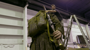 Rob Murphy working on the large scale figure of Sergeant Cecil Malthus. Photo by Weta Workshop.