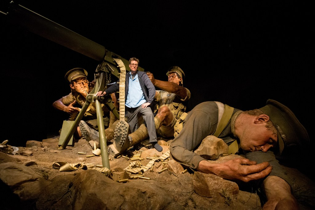 Weta Workshop's Sir Richard Taylor with the machine gunners trio. Photo by Michael Hall, Te Papa