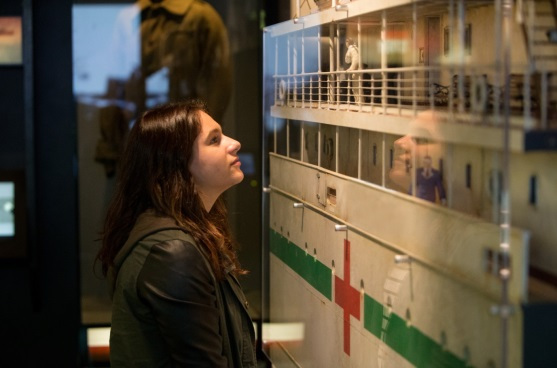 A visitor looks at the cut-through model of the Maheno hospital ship. Photo by Michael Hall, Te Papa.