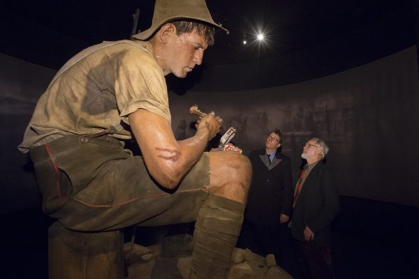 Weta Workshop's Sir Richard Taylor and Pat White are dwarfed by the model of Jack Dunn (Pat's great uncle) at the opening of the Gallipoli exhibition, 2015.